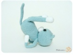 Knitted teddy bear in half shoulder stand