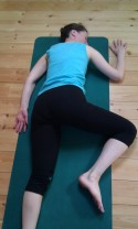 Picture of person lying in flapping fish pose