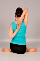 Gomukhasana pose from behind
