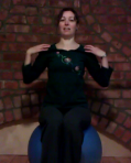 Woman sitting on a large ball