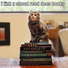 Cat sat on a pile of books