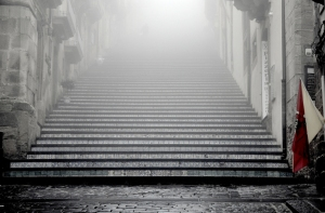 Stone steps in misty Italian passageway