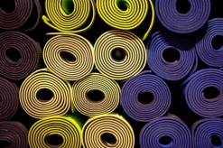 View of rolled up yoga mats end on