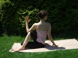 Women in seated yoga pose - ardha matsyendrasana