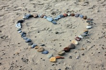 Heart shape from stones on beach