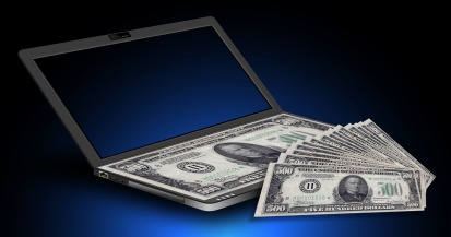 Laptop with dollars on keyboard