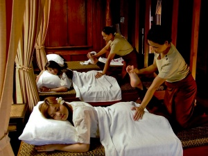 Two people receiving a Thai massage
