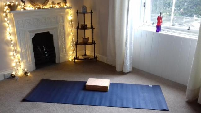 Room with yoga mat