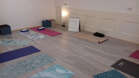 Yoga mats laid out in circle in room