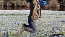 Alyson jumping in frosty field
