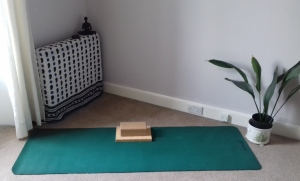 Room with yoga mat and blocks