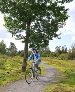 Female cycling in forest