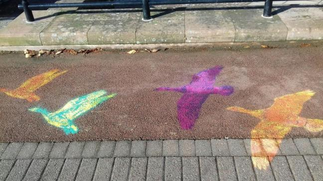 Chalk drawn geese on pavement